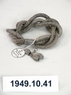 1949.10.41 Bracelet made from Mrs Farrer's plaited and netted grey hair in January 1867. Donated by Pastorella Shelley.