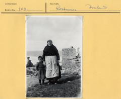 1965.5.1.114 [Front] Woman and grandson Aran Islands, Ireland photographed by Thomas H. Mason