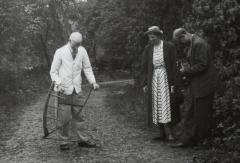 1965.5.1.275 J.F. Parker using a scythe with Ingegard Vallin & Albert Sandklef. Photo by Ettlinger 1948