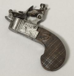 English pocket pistol tinder-box bequeathed by Balfour 1938.35.1101