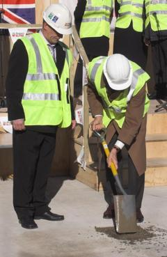 John Hood takes part in the topping out ceremony