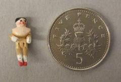 1944.7.61 The doll set beside an English 5p coin for scale. Photographs taken with microscope camera by Conservation Department