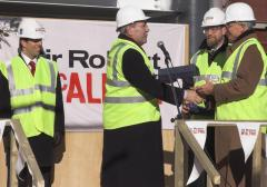 The topping out ceremony, John Hood receives his ceremonial trowel